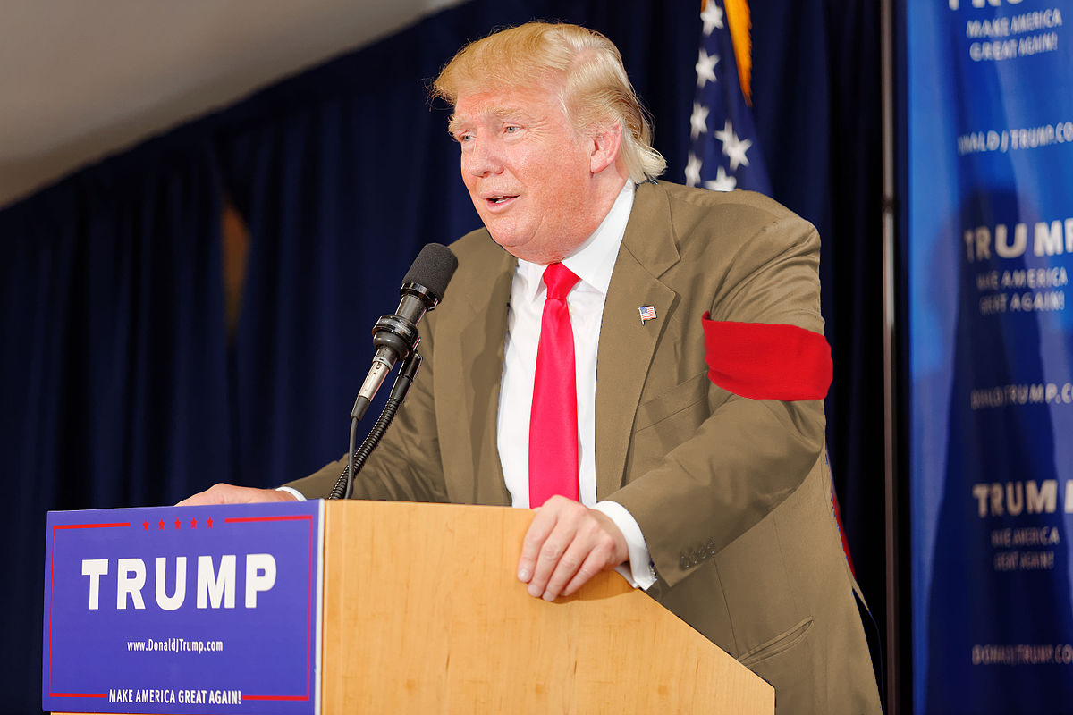 """Trump Promises Khaki Suit and Red Armband Merely """"Fashion"""